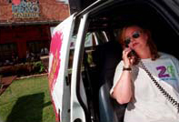 Tracy McLain talks on the phone in the Channel Z van